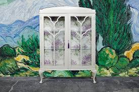 vintage two door glass display cabinet