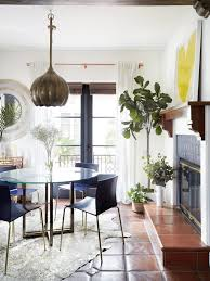 colorful modern furniture. Dining Room With Round Table, Cow Skin Rug And Fiddle Leaf Fig Plant Colorful Modern Furniture F