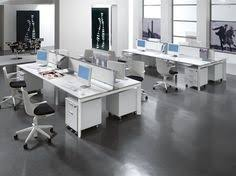modern office desk furniture. simple and creative modern office interior wide space for many employes with white furnitures of work desk two wall hangings furniture