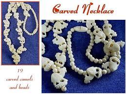 carved ivory elephant necklace value wallpaper