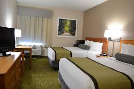 a bed or beds in a room at days inn suites by wyndham madison
