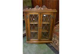 charm oak wall mounted corner cabinet