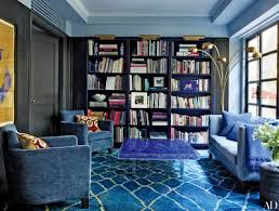 in the library of accessories designer fiona kotur s hong kong home the pair of liaigre armchairs and the custom made sofa and its pillows are
