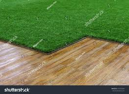 fake grass texture. Artificial Grass And Wooden Floor Texture. Indoor Outdoor Decoration For Wall Walkway. Fake Texture T