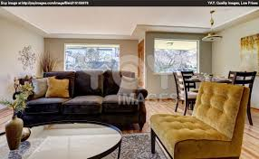 yellow living room with brown couch living room