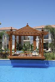gazebo next to pool. this is a pergolastyle gazebo due to both the open roof and next pool o