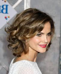 big brown curls with blond highlights