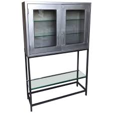 vintage metal dentist cabinet with glass doors and custom iron base for
