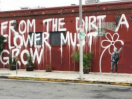 from the dirt a flower must grow mural on the side of snake pit bar and on wall mural artist los angeles with the most unique wall art around los angeles california