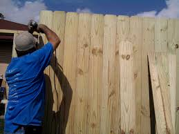 how to put up a wooden fence best wooden fence posts with build a facade around metal