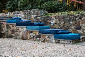 blue floor cushions made using sunbrella fabrics stacked on outdoor steps