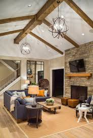 sisal rug cozy contemporary rustic family room stone fireplace vaulted ceiling with exposed ceiling light sloped lighting im