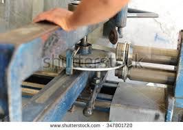 sheet metal worker. bending,worker at manufacture workshop operating cidan folding machine,sheet metal work sheet worker