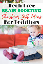 Toddler unwrapping Christmas gift with text overlay Top 10 Gift Ideas For 2 Year Old\u0027s \u2013 Tech Free \u0026 Brain