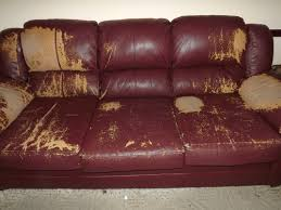 distressed leather sofa furniture rustic with wooden flooring and