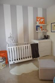 ... Grey And White Striped Accent Wall In This White And Grey Nursery