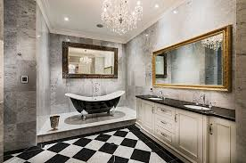 bathrooms contemporary master bathroom with glass chandelier above cornered bathtub and modern vanity cabinet classic
