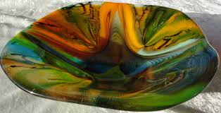 fused glass plates and bowls can serve as a reminder of the beautiful dinner out that all of you just shared