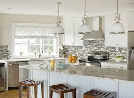 Light Granite Kitchen Countertops Below Glass Pedestal Fruit Bowl And Blue  Ceramic Plate Across Delta Gooseneck