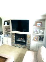 built in shelves around fireplace custom shelving a into tv b