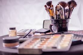 diffe makeups and brushes presented on a table