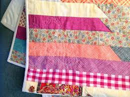 How to Sew A Jelly Roll Race Quilt - Wise Craft Handmade & Jelly Roll. I spent the afternoon doodle stitching/quilting away. A bit  rumpled in a few places where I was having some tension problems, but  overall I am ... Adamdwight.com
