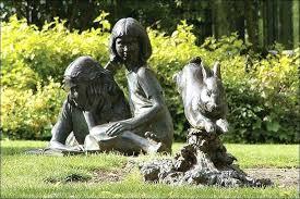 alice in wonderland garden statue sculpture of and the white rabbit alice in wonderland garden statues