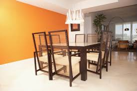 brightly painted orange dining room