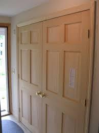 gold door handles featuring bifold closet doors and wooden