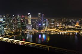 infinity pool night. Singapore Skyline From Infinity Pool At Night