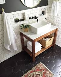 white tiles on the walls and black hexagon tiles on the floor for a contrast