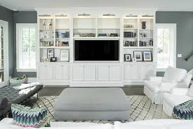 built in living room furniture. interesting living white and charcoal gray living room features a pair of white slipcovered  chairs facing ottoman atop beni ourain rug builtin tv  intended built in living room furniture