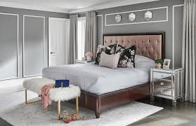 pink leather tufted bed with mirrored