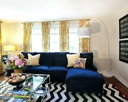 navy blue couches living room chevron rug navy sofa yellow print curtains more dark blue velvet