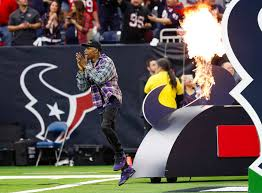 travis scott on the field for texans colts playoff game houston chronicle