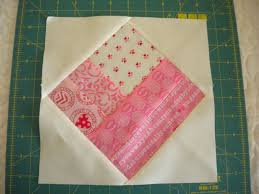 How to Make a Square-in-a-Square Quilt Block: A Tutorial & Step 2: Add Remaining Triangle Pieces Adamdwight.com