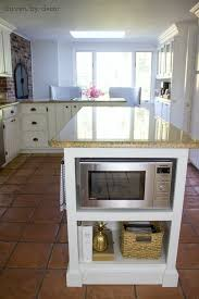 our remodeled kitchen island with built in microwave shelf driven
