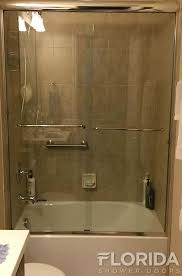 frameless bypass shower enclosure with two towel bars and chrome hardware finish