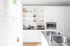 Open Shelving In Kitchen Kitchen White Open Shelving On The White Wall Above The Silver