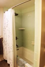 bathtub surround in beautiful aqua glass tile