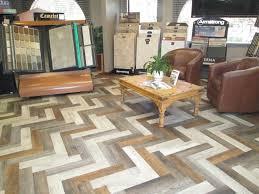 luxury vinyl planks in herringbone pattern slaughterbeck floors