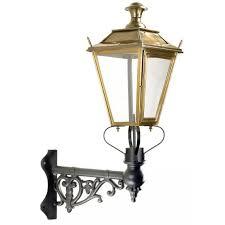 antique brass dorchester wall light on corner bracket