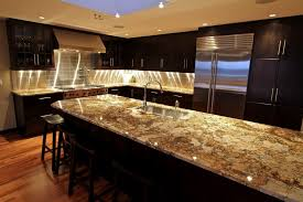kitchen island granite countertops warm white led recessed light double door refrigerator gooseneck spout single handle