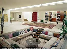 A rare colour photograph shows a classic 1960s sunken living room, complete  with brightly coloured