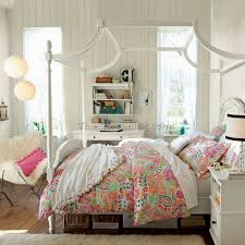 girly bedroom ideas. half fairly in pink, typical teenager, this bedroom mixes floral wallpaper, posters and flea market finds. the result\u0027s a girly with classic ideas