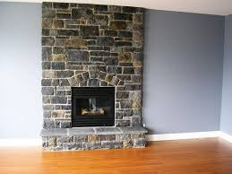 best cobblestone fireplace on interior with dark slate cobblestone fireplace the stone showroom