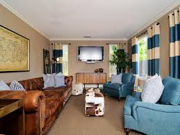 Living Room Blue And Brown Living Room White Shelves Gray Sofa Brown Chairs Gray Recliners
