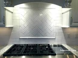 kitchen stove backsplash over the stove ideas herringbone pattern over stove kitchen stove backsplash stainless steel kitchen stove backsplash