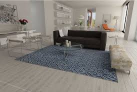 blue and gray diamond patchwork cowhide rug in an open living room with a big dark