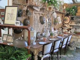 As you walked under the doorway piece you came across this table and chairs  and awesome silver domes: